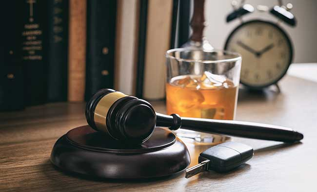 Gavel, drink and a car key on a Cook County attorney's desk