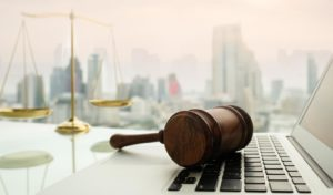 gavel on a laptop with view of Chicago city